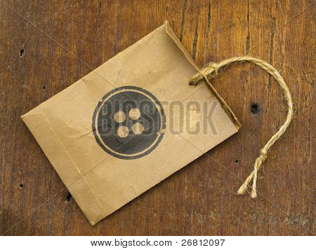 paper bag with button as a label