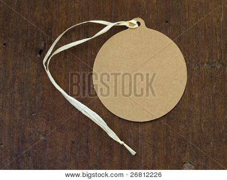 oval tag over wooden background