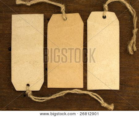 blank tags on the wooden background