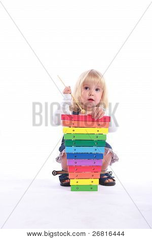 Cute Girl Playing A Musical Toy