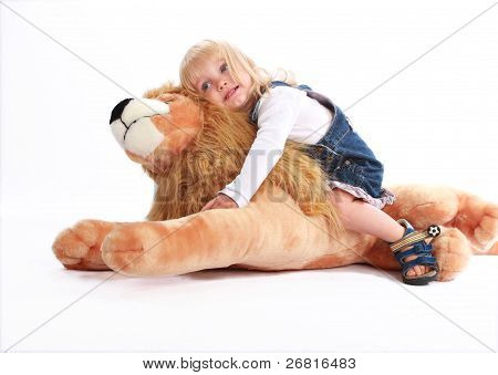 Girl Leaning On A Toy Lion