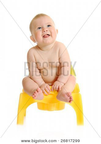 Small smiling baby and chamber-pot isolated
