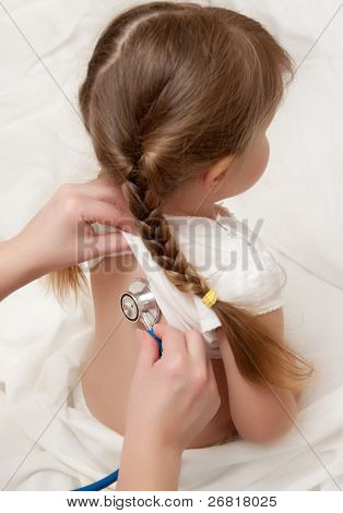 Listening of little girl by stethoscope