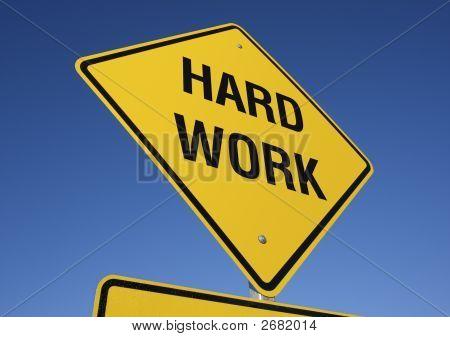 Harte Arbeit-Straßenschild