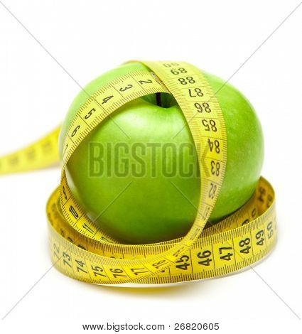 Green apple with centimeter tape