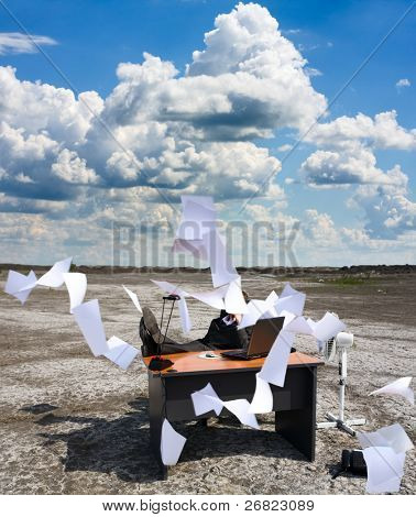 A businessman  with his paperwork.Recession.