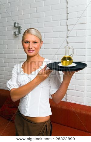 Waitress holding dish in the uniform