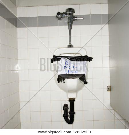 Broken Urinal.