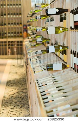 Wine shop, bottles on shelfs