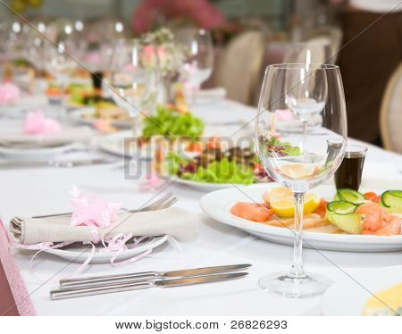 Modern tableware and glasses on a table