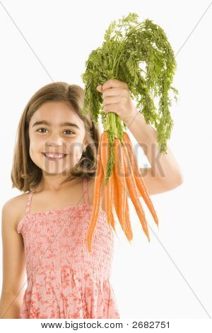 Girl Holding Carrots.