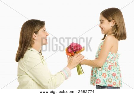 Girl Giving Mother Flowers.