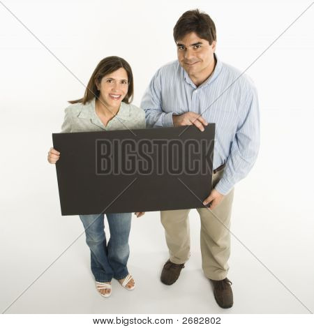 Couple Holding Blank Sign.