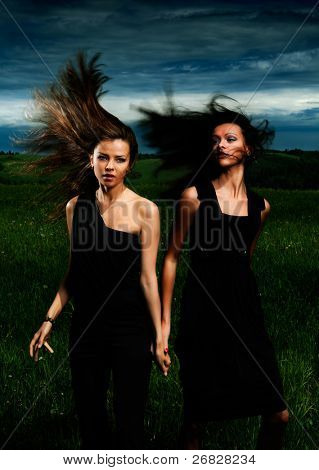 Portrait beautiful girls with great fly-away hair on a background of a landscape