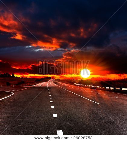 landscape with road and cloudy sky
