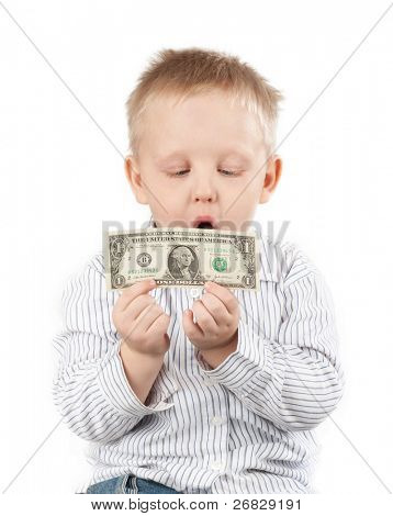 Little boy holding money with a happy surprised look