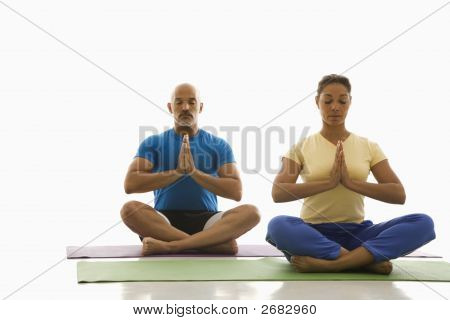 Two People Practicing Yoga.