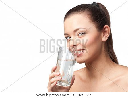 Happy beautiful woman holding a glass of water, isolated on white