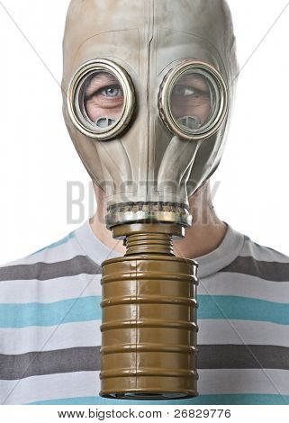 Man in gas mask squinting against white background