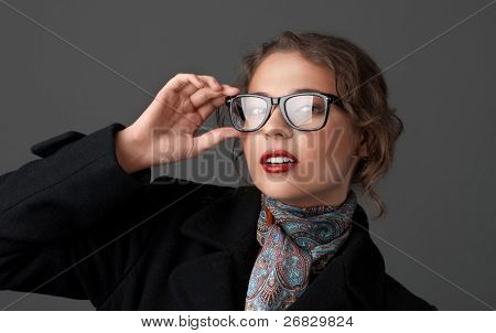 Young pretty woman with a horn-rimmed glasses