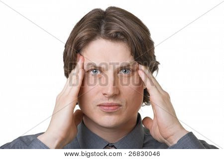Handsome young man tests a headache against white background