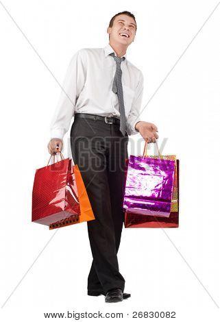 Empresario feliz con muchos shoppingbags contra fondo blanco