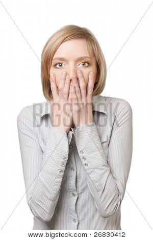Portrait of surprised beautiful woman with blond hair covering mouth with hands