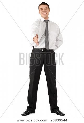 Handsome young businessman stretches out his hand to introduce himself