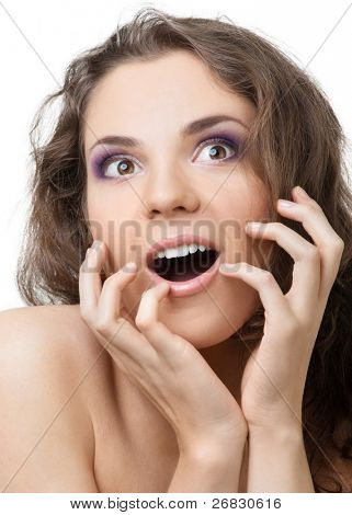 Close-up portrait of a surprised beautiful woman with open mouth over white background