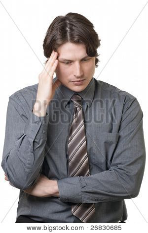 Portrait of thoughtful businessman touching his temple against white background
