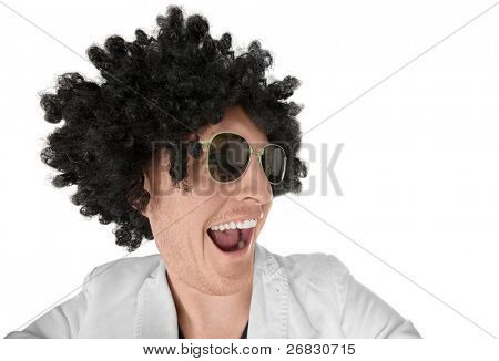 Close-up of funny looking guy with black curly wig, over white background