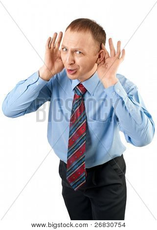 Businessman cups hands to his ears to hear better, isolated on white