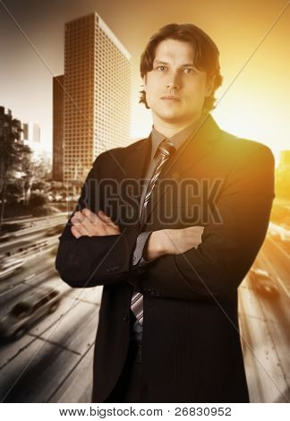 Portrait of a confident businessman with crossed arms