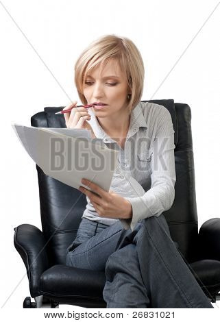 Attractive businesswoman sitting in the armchair and holding documents and pen, isolated on white