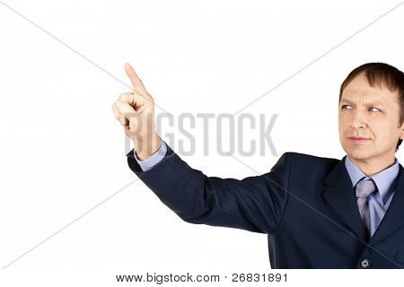 Portrait of a confident businessman pushing on invisible touch screen, over white background