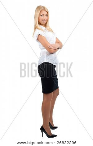 Full length portrait of young businesswoman with crossed arms smiling, isolated on white background