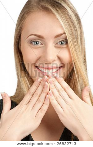 Close-up portrait of surprised attractive woman covering her mouth by the hands, over white background