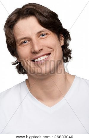 Portrait of handsome young man smiling, isolated on white