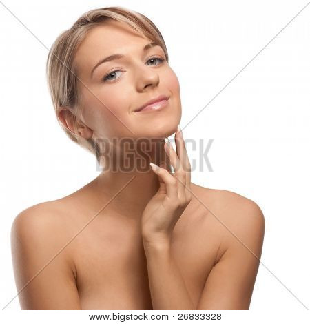 Portrait of beautiful girl with perfect skin and natural makeup touching her face and smiling, over white background