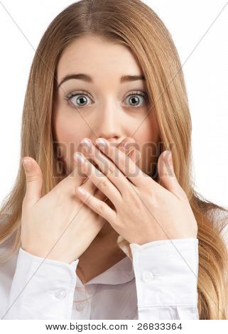 Close-up portrait of surprised attractive businesswoman covering her mouth by the hands, over white background