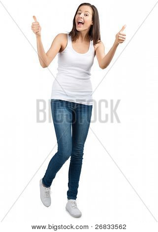 Full length portrait of a happy young woman laughing and showing thumbs up, against white background