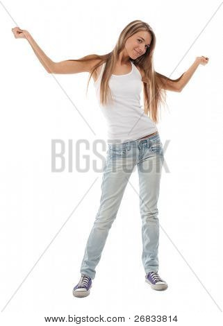 Full length portrait of happy dancing girl with arms extended . Over white background