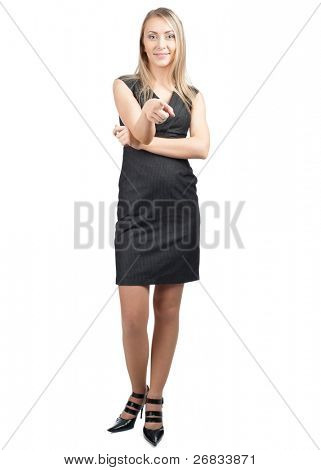 Full length portrait of attractive business woman pointing at viewer, against white background