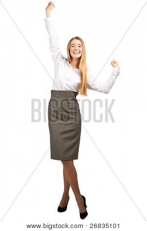 Full length portrait of successful young business woman raising her arms in joy and smiling. Isolated on white background