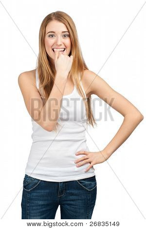 Portrait of excited young woman biting her nails. Isolated on white background