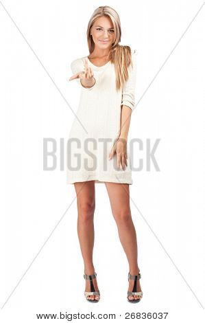 Portrait of a pretty young woman pointing her finger at you against white background