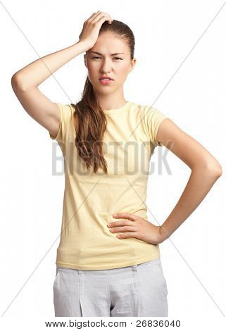 Portrait of woman having a headache and touching her head, against white background