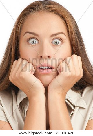 Portrait of surprised excited young woman with eyes wide open