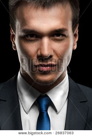 Close-up portrait of handsome business man looking at camera