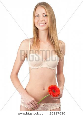 Portrait of young beautiful woman with perfect slim body in lingerie holding red flower in her hands. Isolated on white background